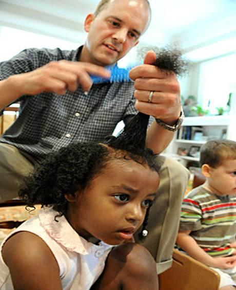 Emory Professor Clifton Green braiding his 4-year-old daughter's hair.